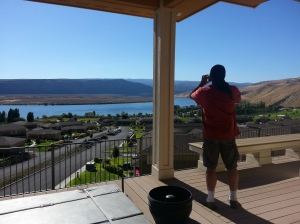 Dave looks out at the Columbia River from the porch of the Hadleys home.