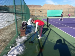 Roberta clears some snow from the courts.  Boy, those windshield ice scrapers come in handy...haha!