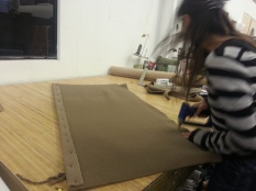 Stapling and gluing the fabric