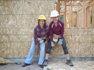 Roberta and Iris demonstrate a very effective way to hammer nails into plywood siding