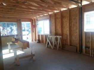 The front room will eventually be the kitchen and the living room