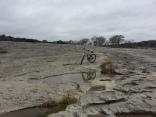 "Roberta's bike parked on the ""moonscape"" of McKinney Falls"