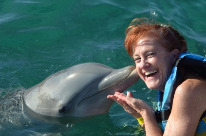 Dolphin kisses tickle