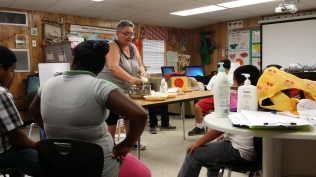 Ms. Cherry teaching the fine art of making a mock apple pie